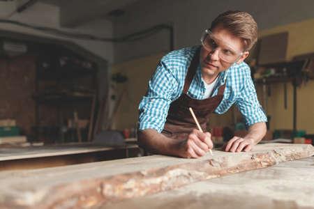 Young carpenter at work Reklamní fotografie