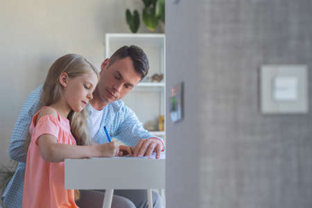 Father and daughter doing homework Reklamní fotografie