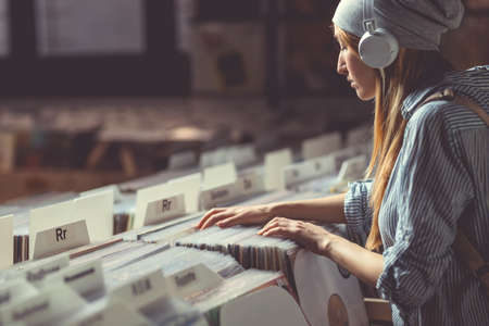 Young attractive woman in music store