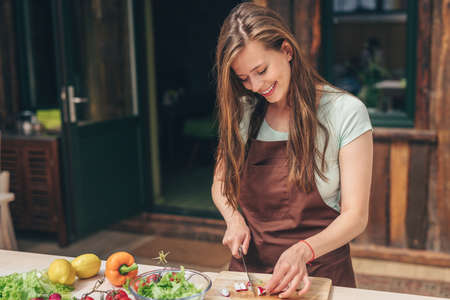 Young attractive girl in the kitchen