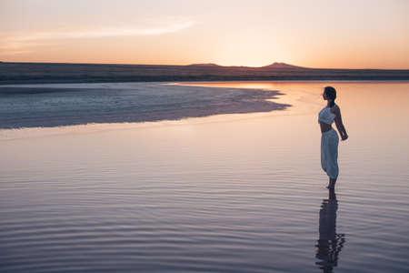 Beautiful woman at sunset