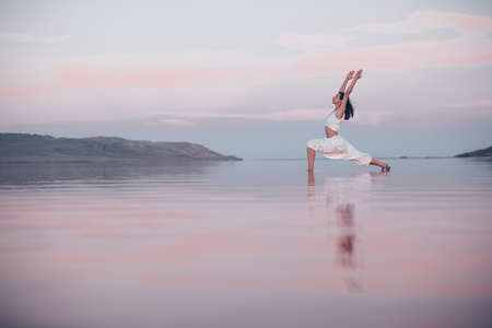 Young woman doing yoga at the lake Reklamní fotografie