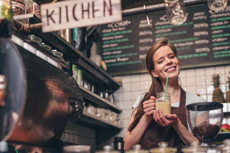 Smiling girl with smoothie