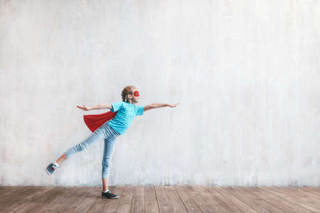 Flying girl hero with a cloak Reklamní fotografie
