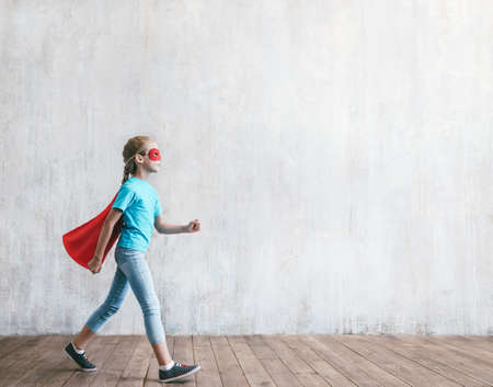 Smiling little girl hero with a cloak Reklamní fotografie