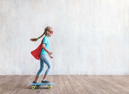 Little hero with a skatboard in the studio Reklamní fotografie