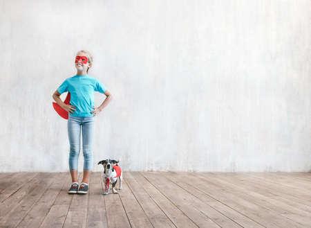 Smiling little girl with a dog Reklamní fotografie