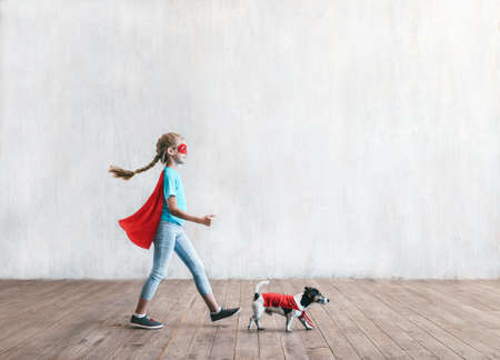 Little superhero with a dog
