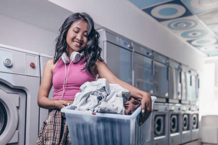 Smiling young girl in laundry Reklamní fotografie