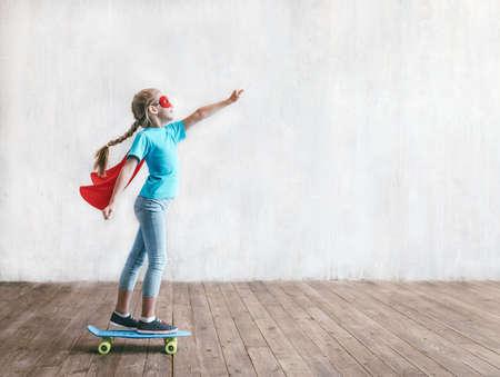 Flying little hero in the studio Reklamní fotografie