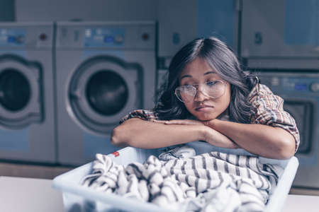 Young woman in laundry