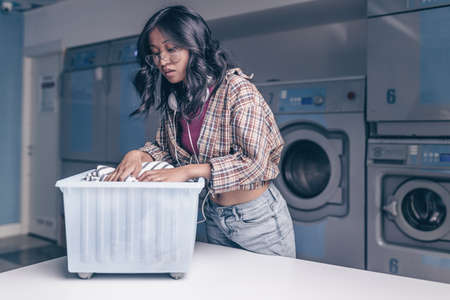 Young attractive woman in laundry