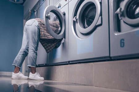 Young girl in the washing machine