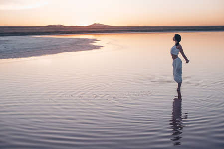 Young girl at sunset