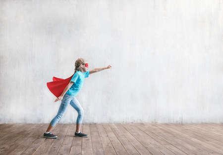 Flying super hero in studio
