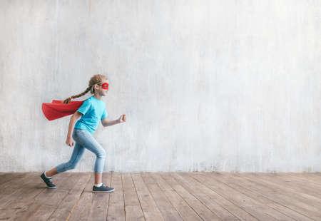 Running little super girl in studio