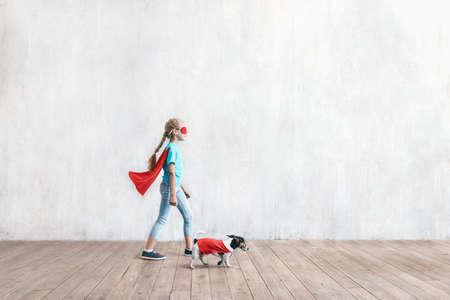 Super girl and a dog Reklamní fotografie