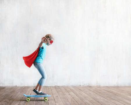 Little girl skating in studio Reklamní fotografie