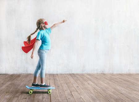 Super girl skating on a skateboard