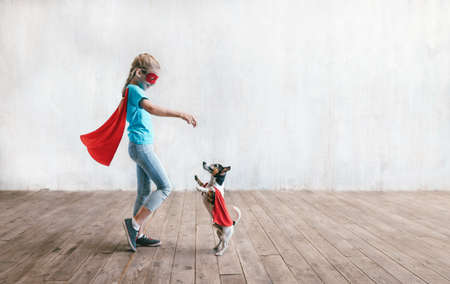 Little super girl with a dog