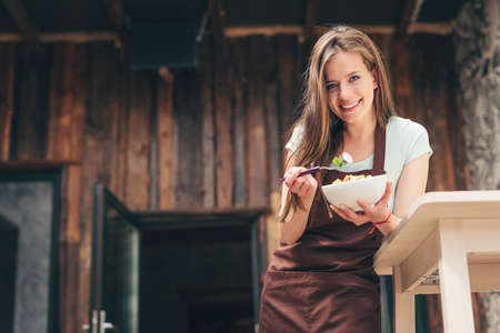 Smiling girl in an apron