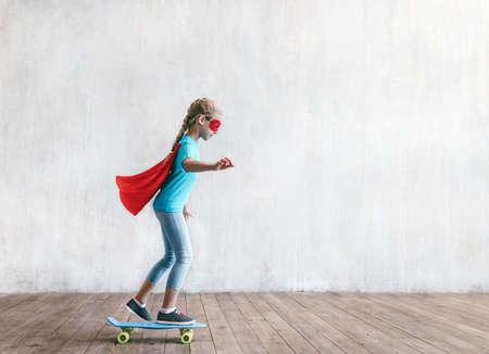 Super girl skating in studio Reklamní fotografie