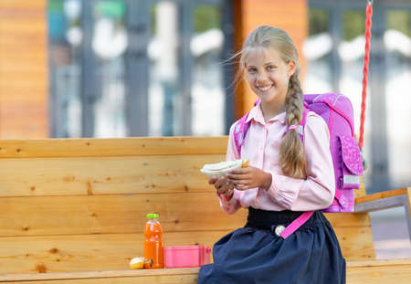 Smiling little girl with lunch Banco de Imagens