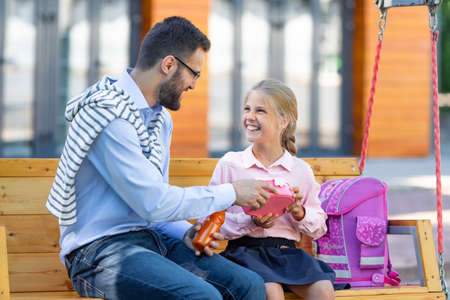 Happy family with lunch outdoors