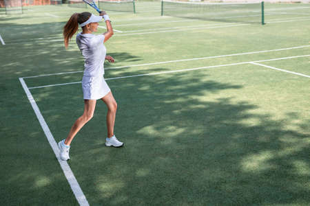 Active young tennis player on the court
