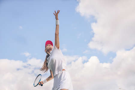 Attractive girl in sportswear playing tennis