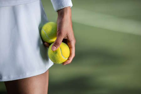 Tennis player in sportswear with a ball close-up Stock fotó