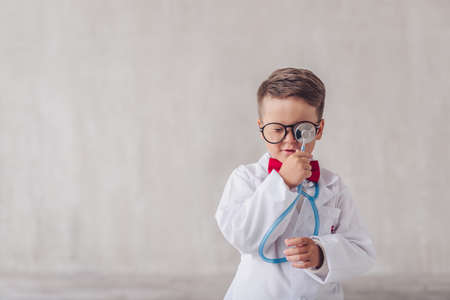 Little doctor with a stethoscope indoors