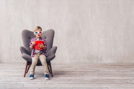 Little child in 3d glasses with popcorn at home Stok Fotoğraf