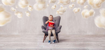Little child eating popcorn in the cinema Stok Fotoğraf