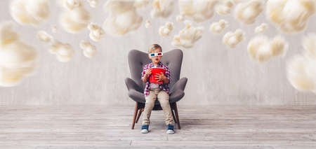Little kid in 3d glasses at home Stockfoto