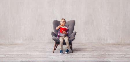 Little kid eating popcorn at home Stok Fotoğraf