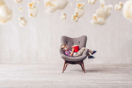 Sleeping little boy with popcorn at home Stock Photo