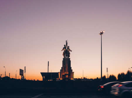 Soviet monument Worker and Collective Farm Girl at sunset