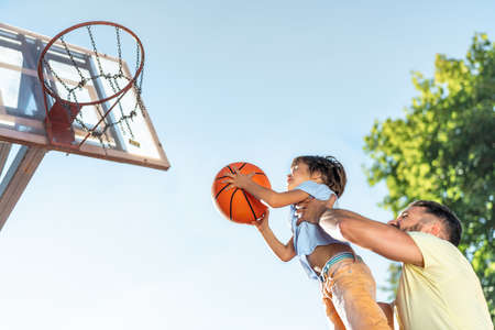 Happy father and son playing basketball Stock Photo
