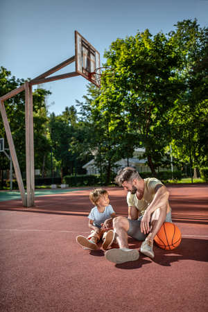 Father and son on the basketball court near the house Reklamní fotografie