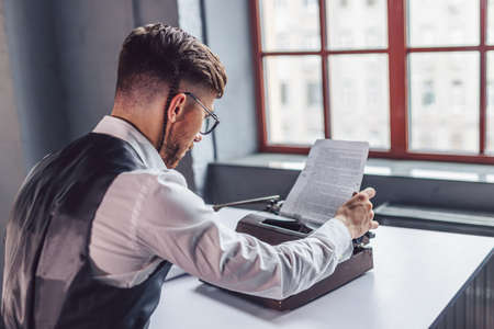 Young professional reading the script in the office Stock Photo