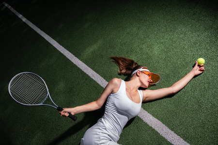 Attractive girl playing tennis on the court