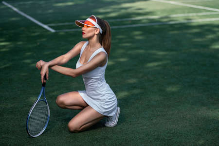 Beautiful sexy girl on the tennis court Stok Fotoğraf