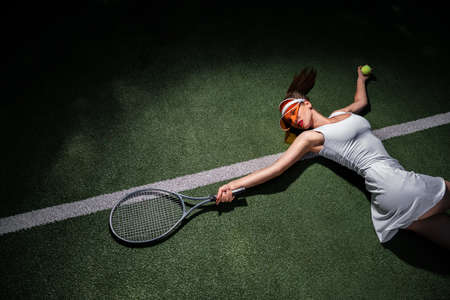 Beautiful woman with a racket on the court
