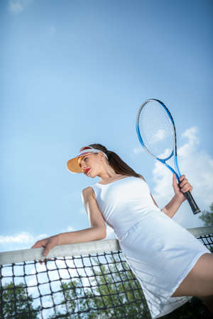 Attractive young model on the court in summer