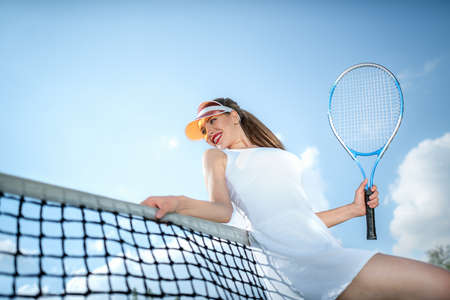 Attractive girl in uniform on the tennis court outdoors Stok Fotoğraf