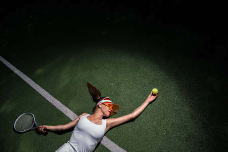 Young girl playing tennis on a tennis court