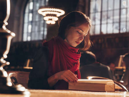 Young student in the library of New York