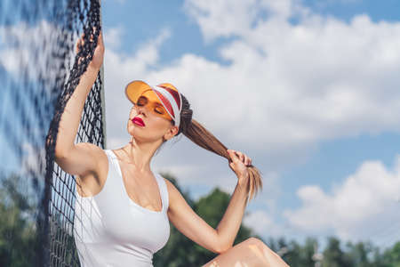 Beautiful girl on the tennis court outdoors Stok Fotoğraf