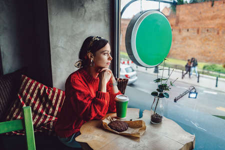 Attractive girl in a cafe in Poland Stock fotó - 115781104
